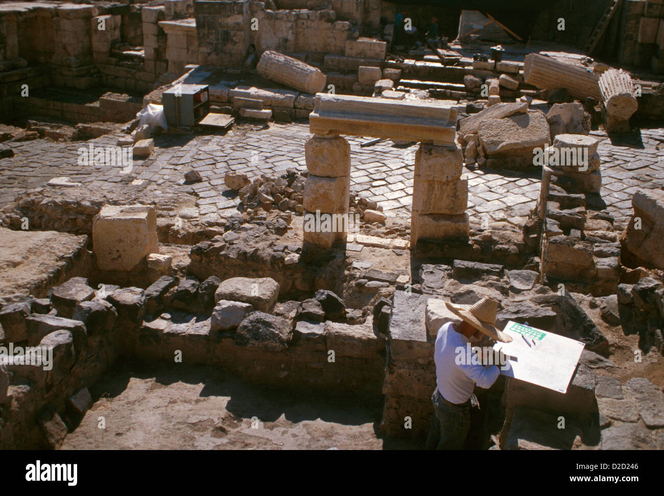 Israel, Beit She'An. Archeologist Executing Site Drawings Amid Ancient Ruins - Stock Image