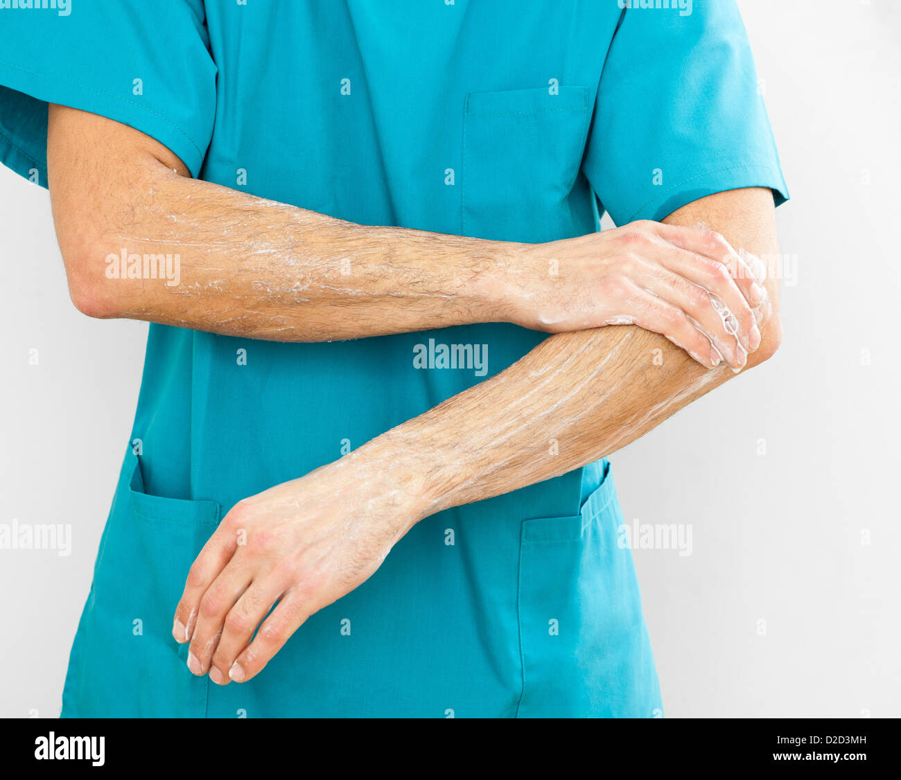 MODEL RELEASED Scrubbing up before surgery - Stock Image