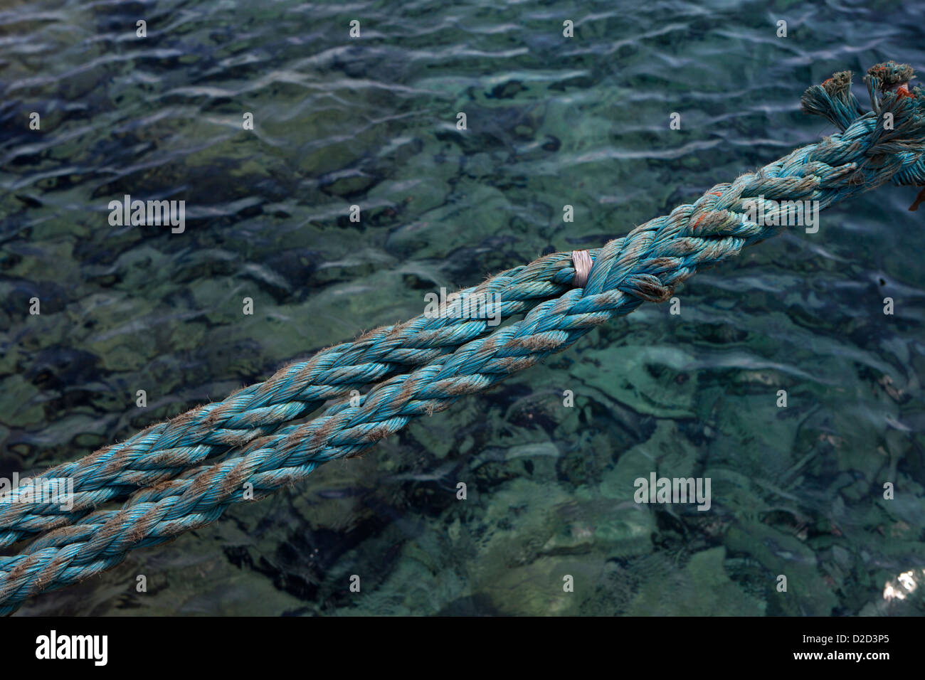 Main line attaching a cruise ship to the wharf. Stock Photo