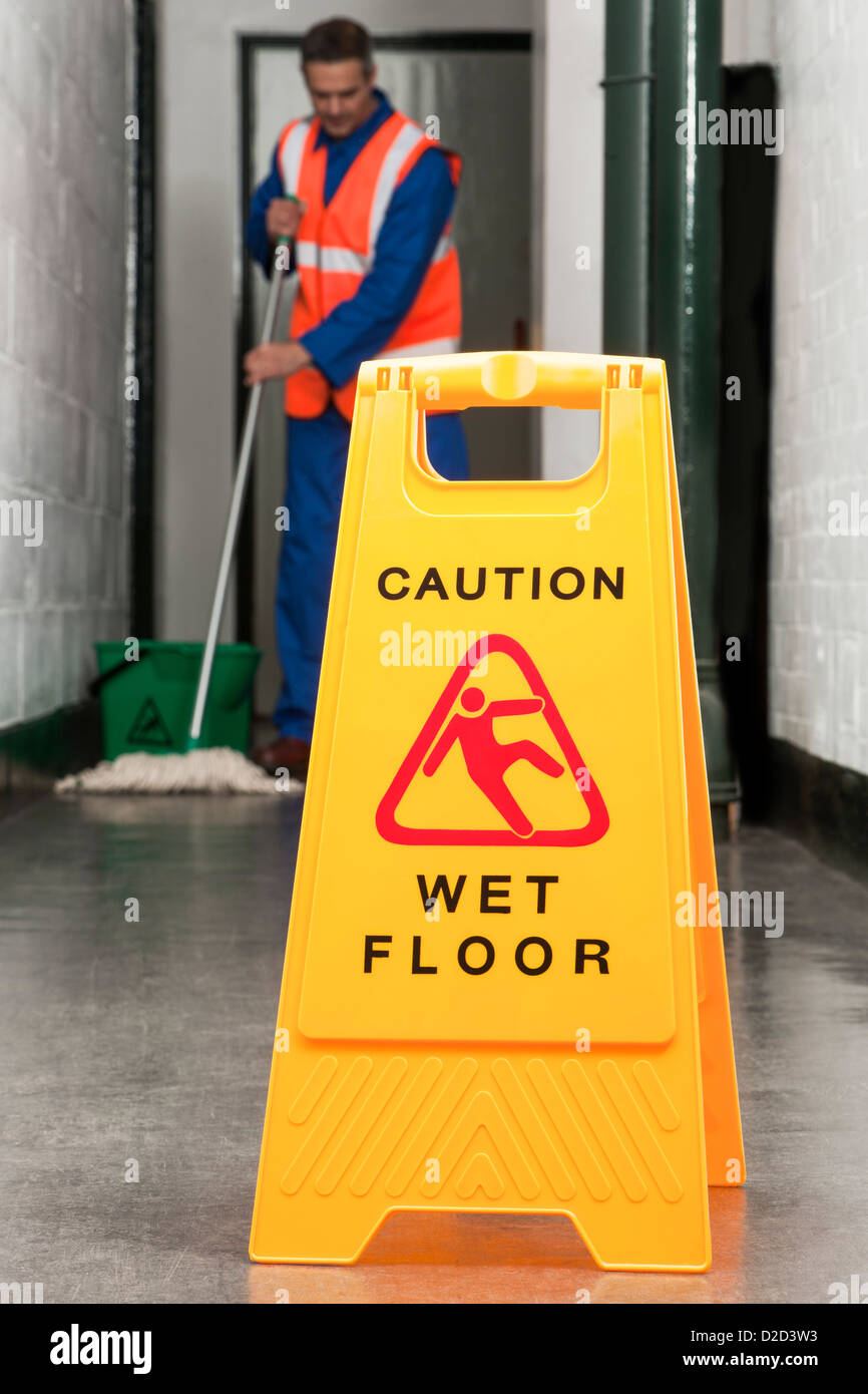 MODEL RELEASED Wet floor sign - Stock Image