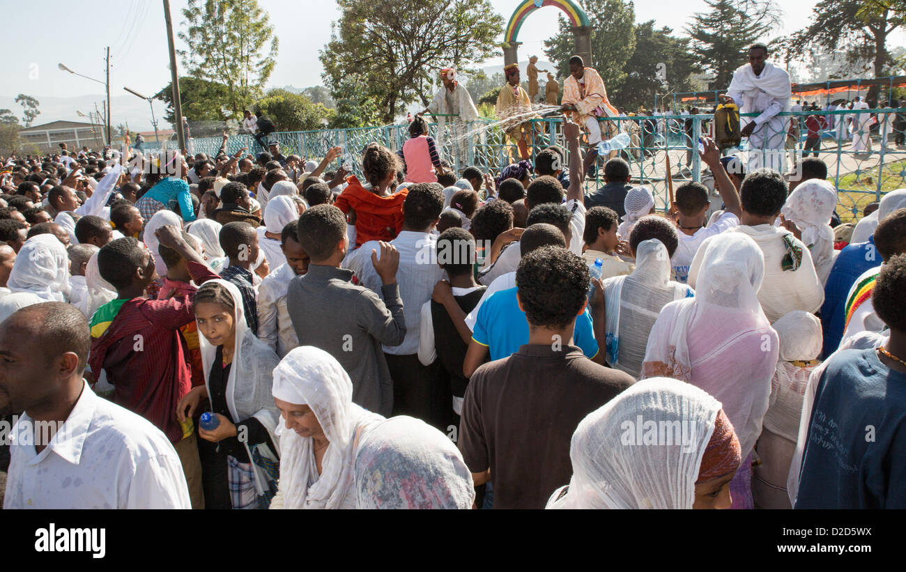 ADDIS ABABA, ETHIOPIA– JANUARY 19: Holy water sprayed on thousands of people attending Timket celebrations of Epiphany, commemorating the baptism of Jesus in the river of Jordan, on January 19, 2013 in Addis Ababa. Stock Photo