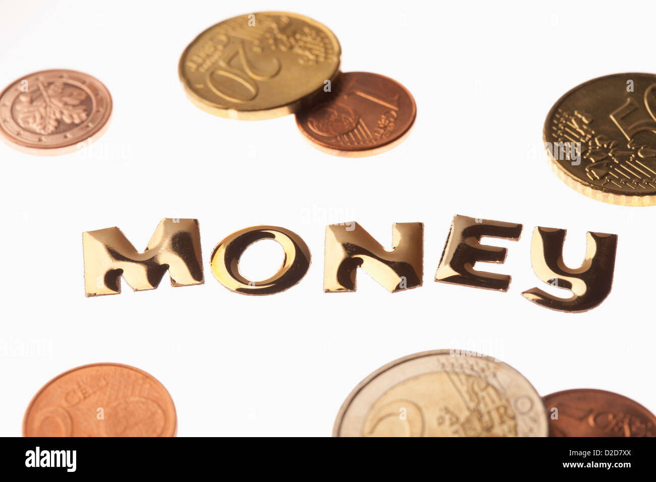 The word 'money' in gold lettering surrounded by euro coins - Stock Image