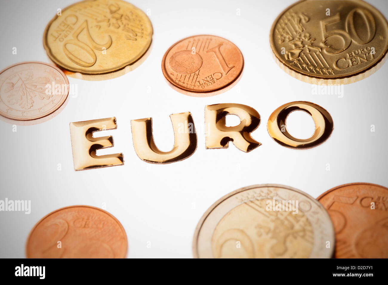 Single word 'money' in gold lettering surrounded by euro coins - Stock Image