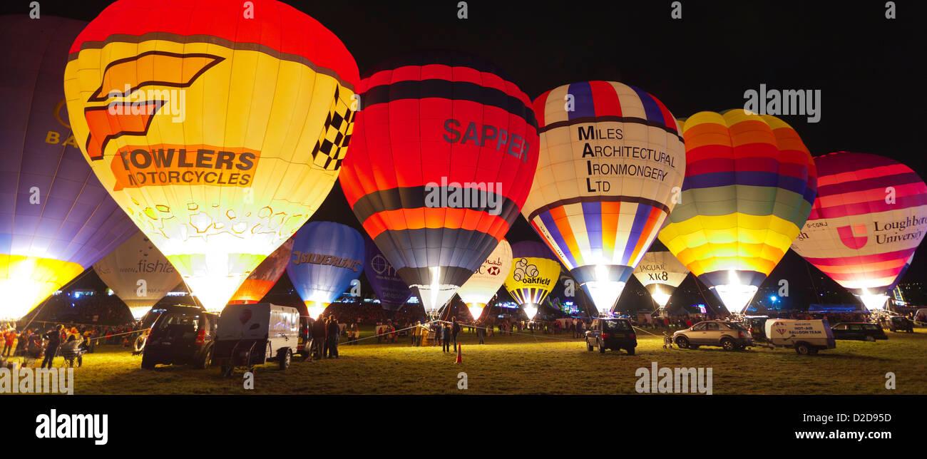 Bristol, UK - August 13, 2011: A row of Hot Air Balloons glow at night for the Bristol Balloon Fiesta at Ashton - Stock Image