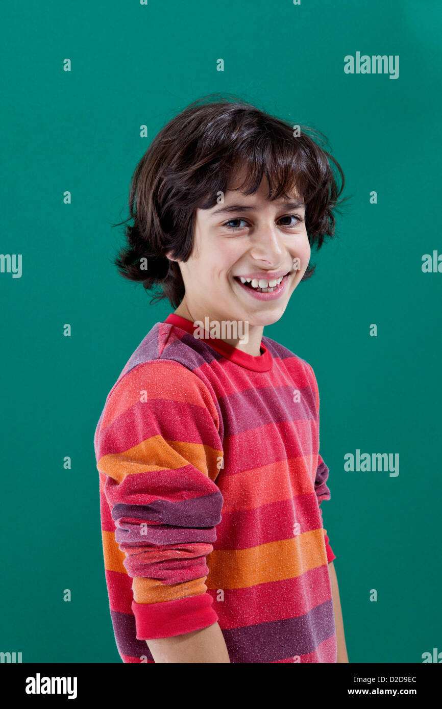 A cheerful preadolescent boy smiling at the camera - Stock Image
