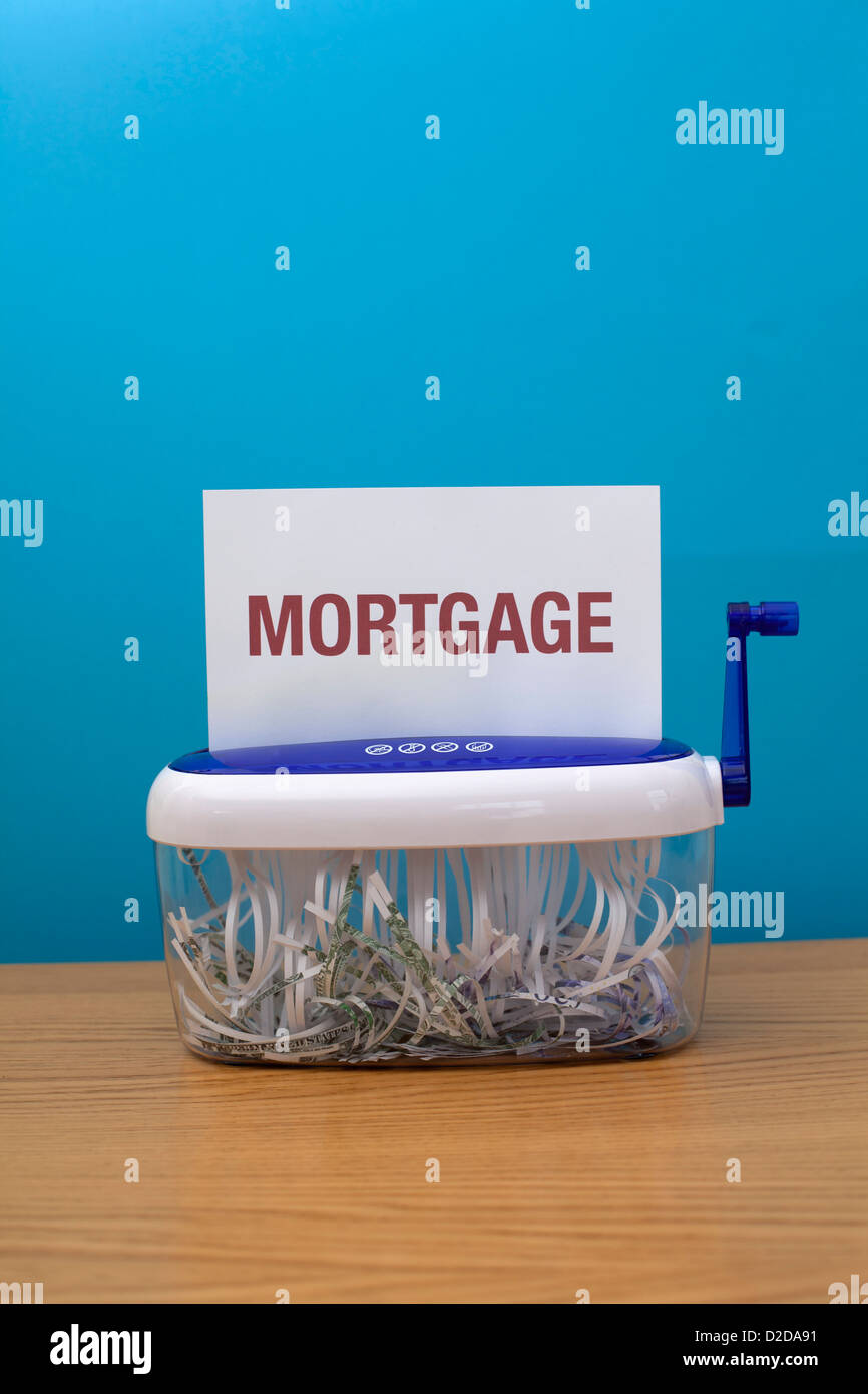The word 'Mortgage' about to be shredded - Stock Image