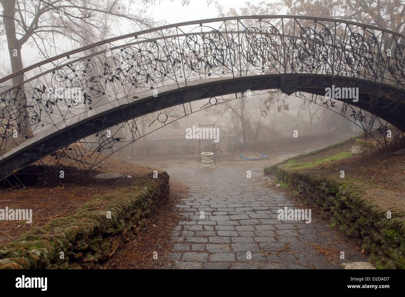 Humpbacked bridge in the fog, Odessa, Ukraine, Europe - Stock Image