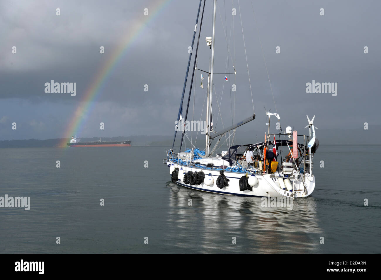 Cruising yacht crossing Gatun Lake, manmade and above Sea Level, after a night tied up to a buoy during Panama Canal - Stock Image
