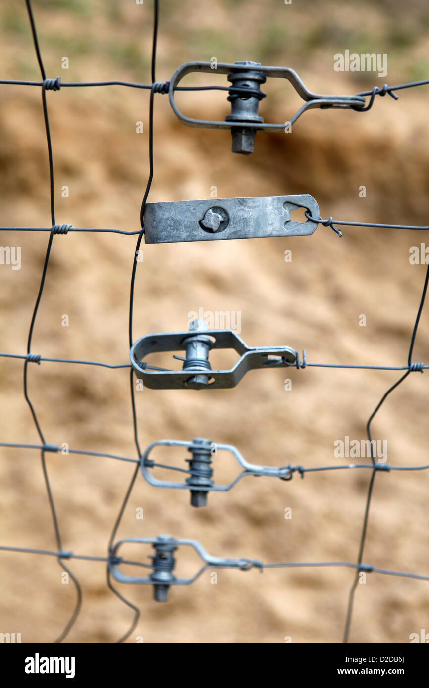 Metal fasteners holding together parts of a fence - Stock Image