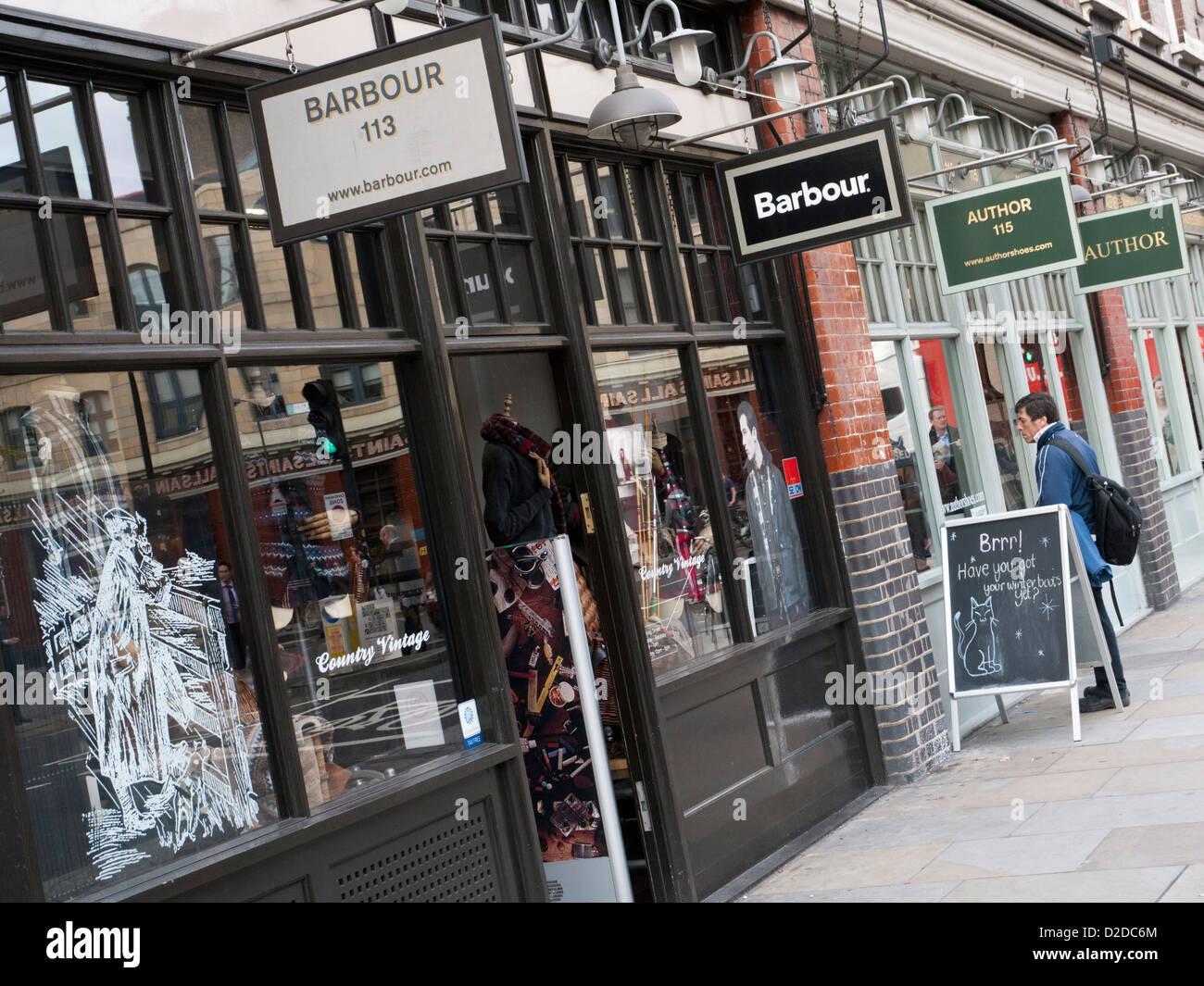 Row of shops in Spitalfields Market, East London - Stock Image