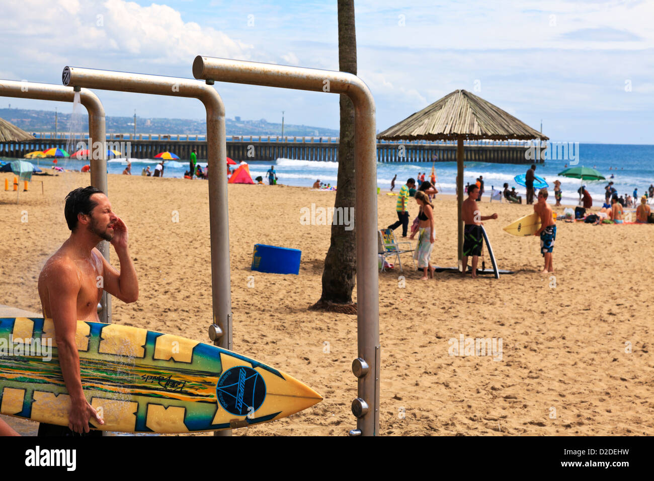 Durban, South Africa. A surfer makes use of the showers placed along ...