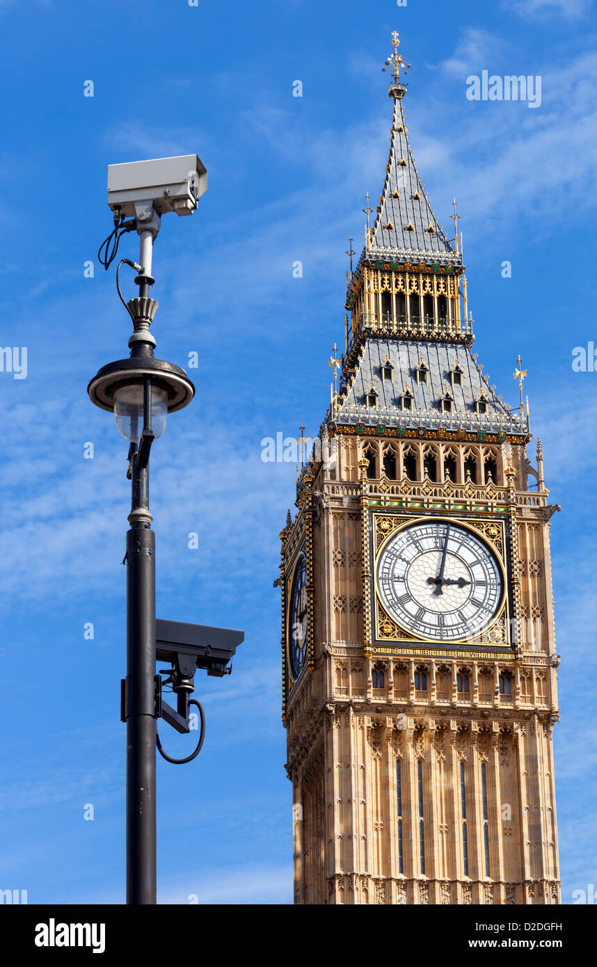 CCTV security cameras mounted on a lamp post in Westminster with Big Ben in the background. Stock Photo
