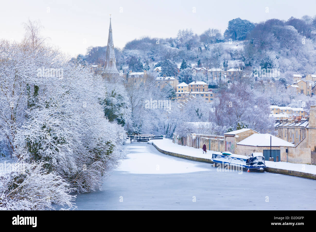 Winter scene with a frozen, snow covered canal in Bath, England. - Stock Image