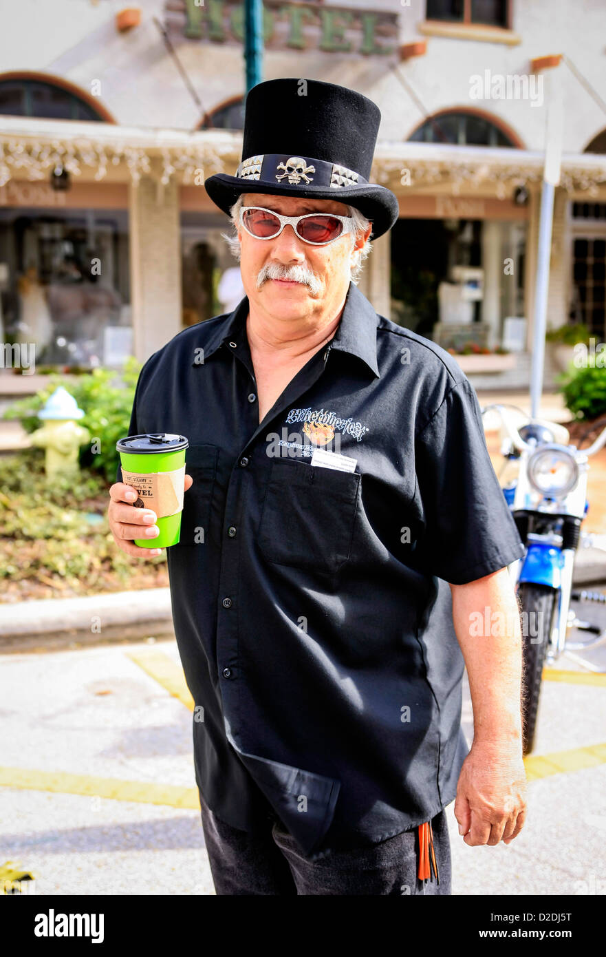 c8aba8ce4ae6 Senior biker wearing a black top hat at the Thunder in the Bay motorcycle  event in Sarasota Florida