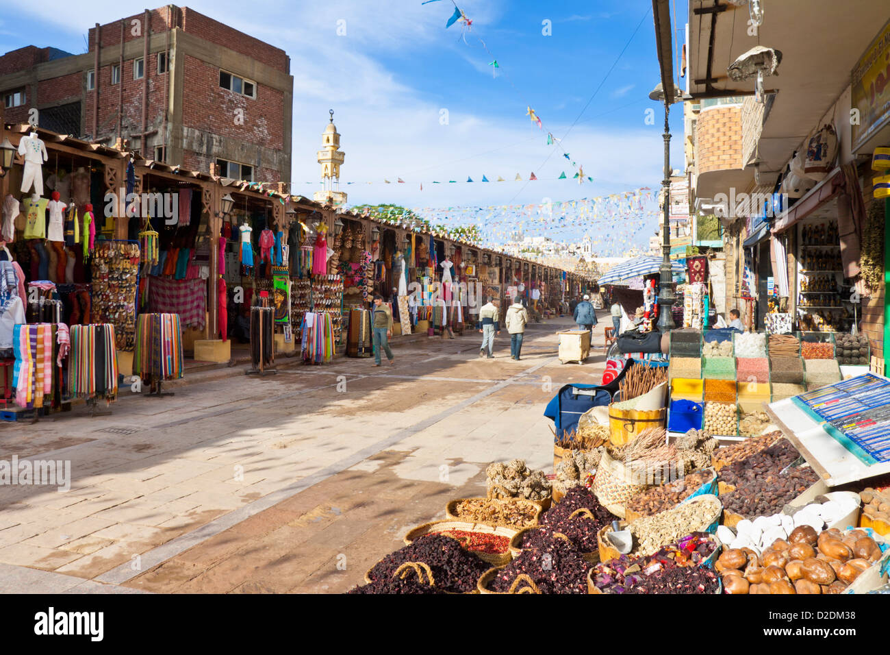Market bazaar street scene with stalls selling spices dyes ...