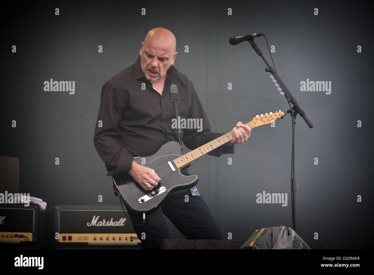 The Stranglers guitarist and vocalist BAZ WARNE on stage at V Festival, Essex - Stock Image