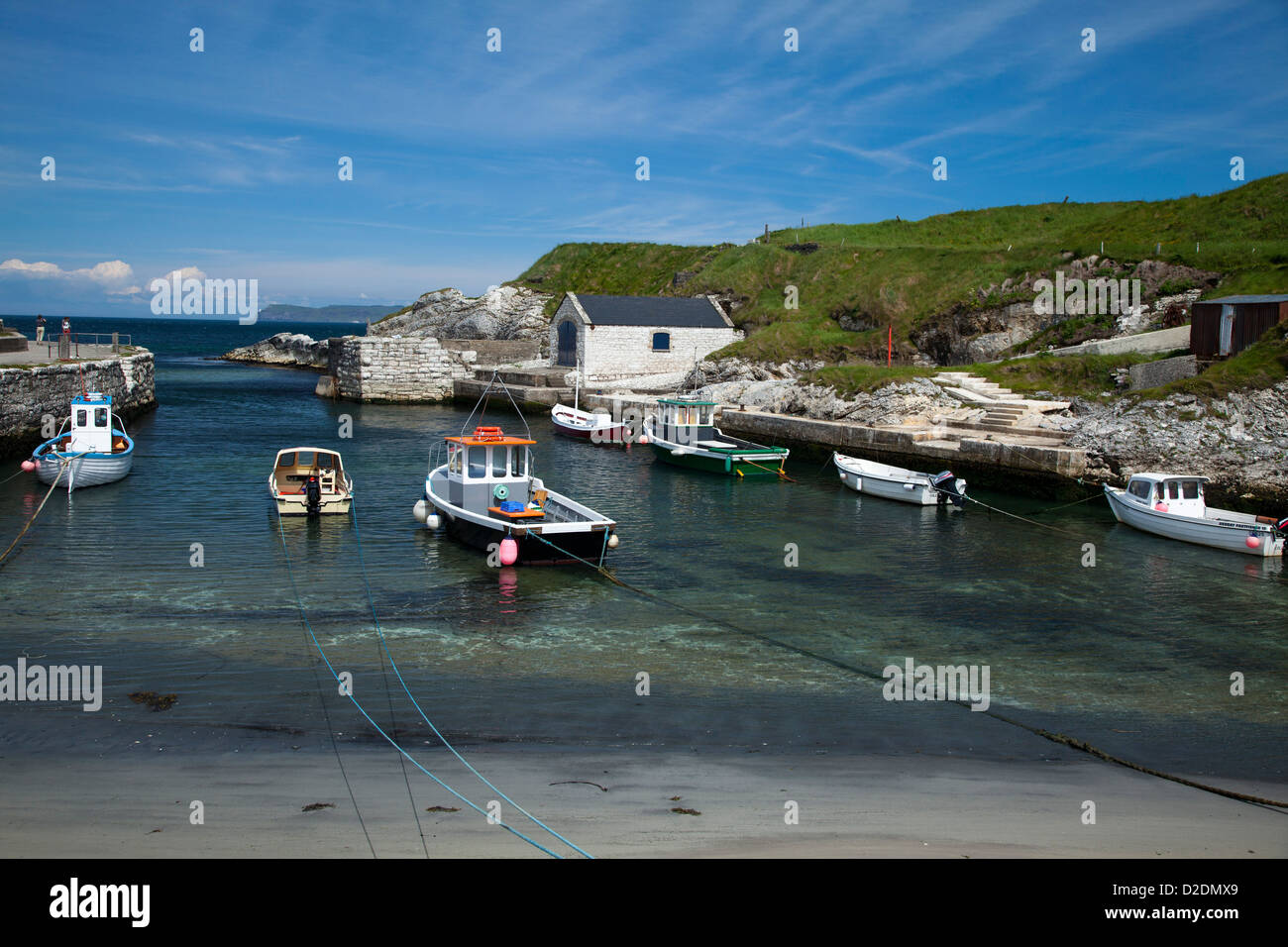 Fishing boats moored in Ballintoy Harbour, Causeway Coast, County Antrim, Northern Ireland. - Stock Image