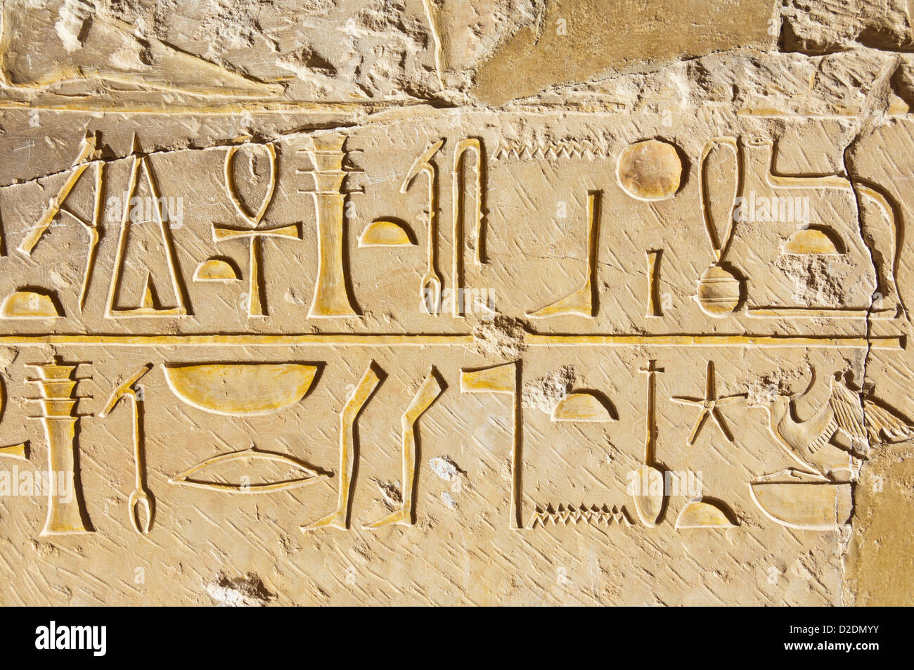 Hieroglyphics on the pillars of the portico to the third terrace of the Temple of Hatshepsut on the West bank of - Stock Image