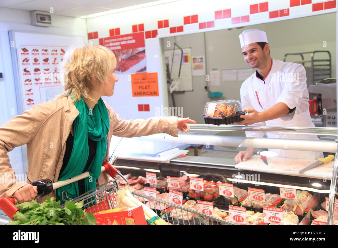 France, supermarket, customer. - Stock Image