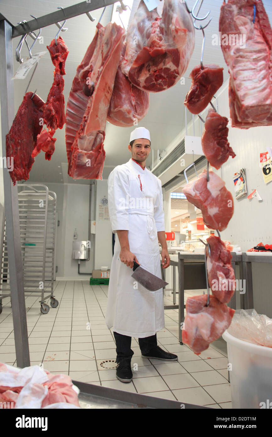 France, supermarket, young butcher. Stock Photo