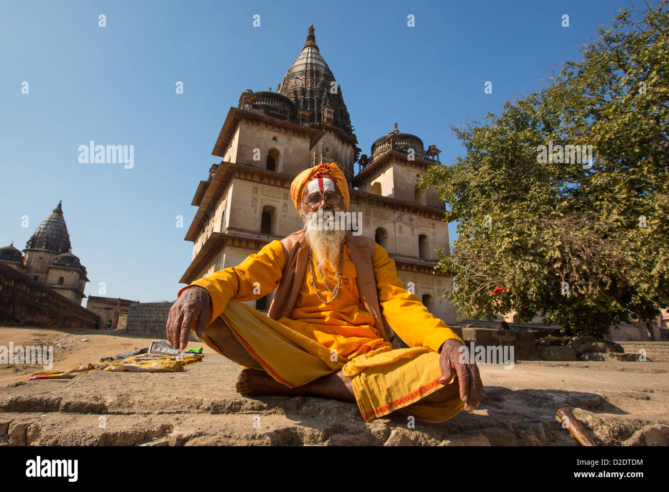 Sadhu in front of Chhatris to Orchha rulers, Orchha, India - Stock Image