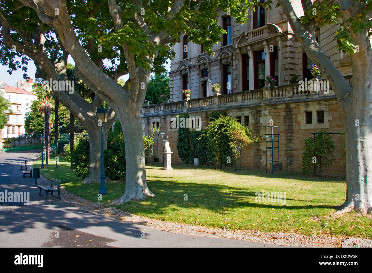Building with imposing facade on the edge of the Parc des Poètes, Beziers, Laguedoc, France - Stock Image