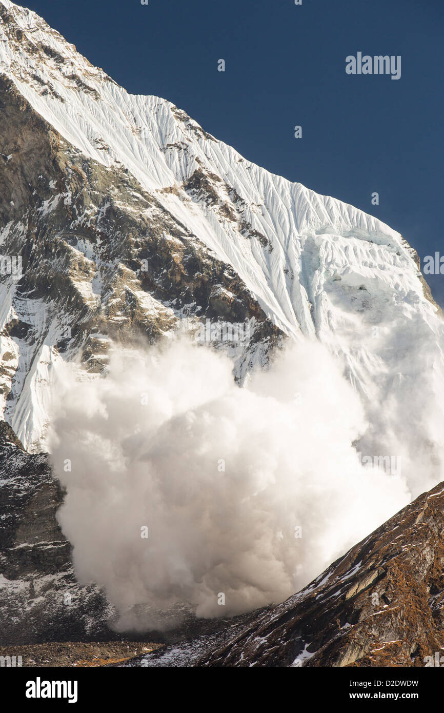 An avalanche on Machapuchare or Fishtail Peak in the Annapurna Himalaya, Nepal. - Stock Image