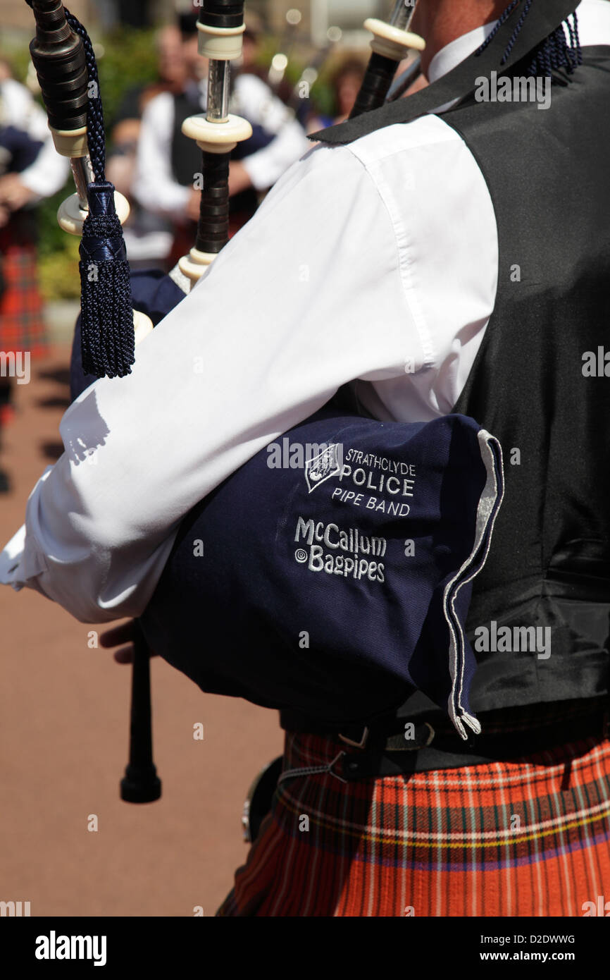 A member of the Strathclyde Police Pipe Band performing at the Piping Live Event in George Square, Glasgow, Scotland, - Stock Image