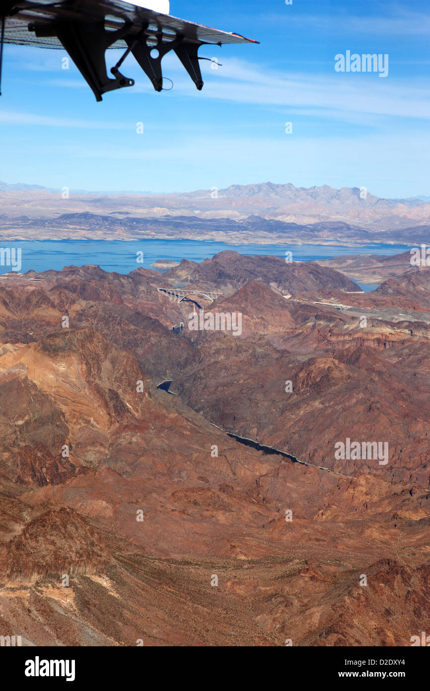 aerial view flying over the colorado river arizona nevada border below the hoover dam usa - Stock Image
