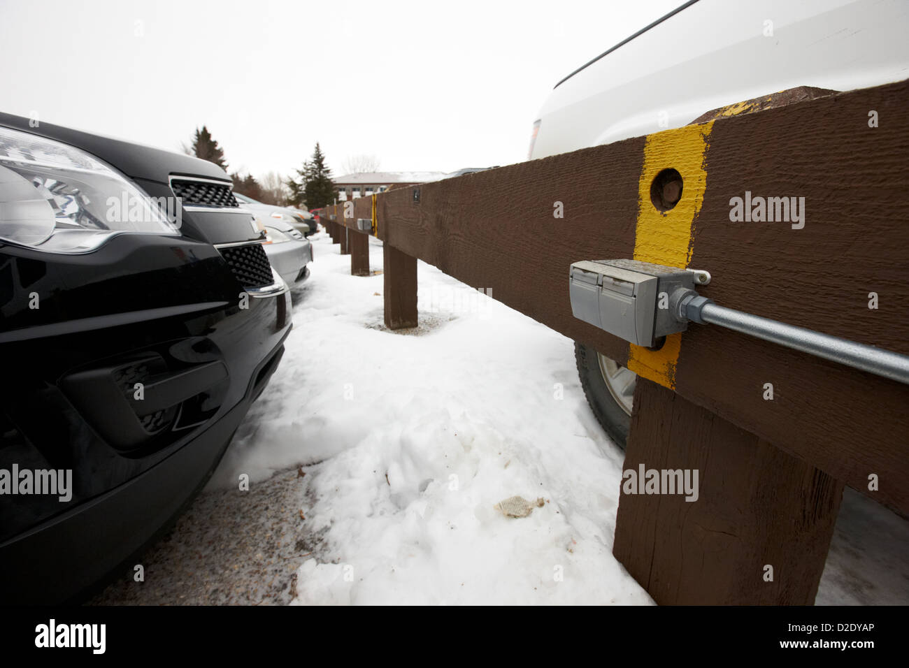 electrical power sockets in outdoor parking lot for engine block heaters saskatchewan canada - Stock Image