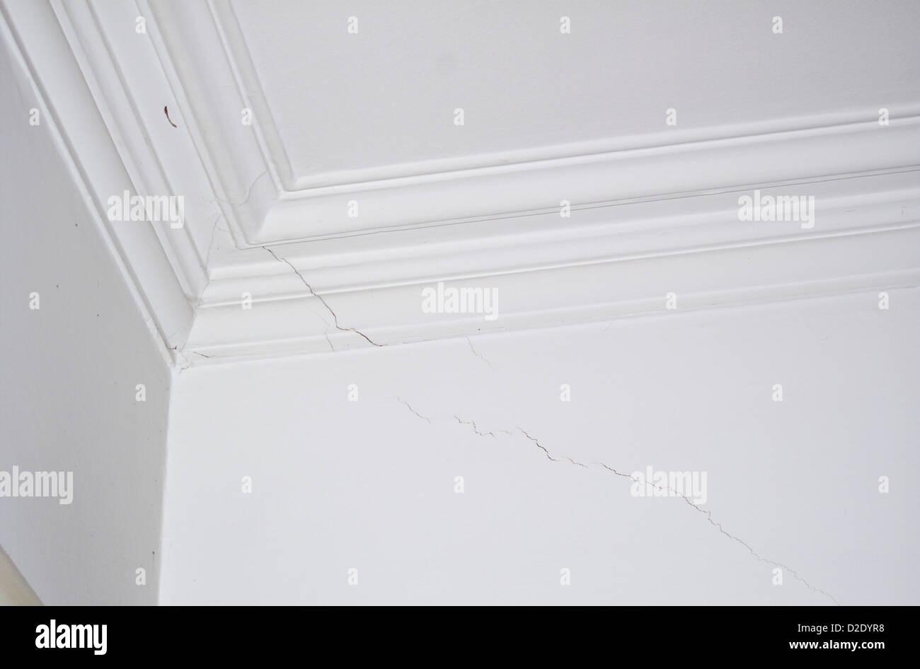 Hairline settlement crack in internal plasterwork - Stock Image