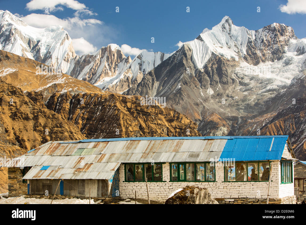 A tea house lodge at Annapurna Base Camp Himalayas, Nepal, looking towards the Fish Tail Peak. - Stock Image