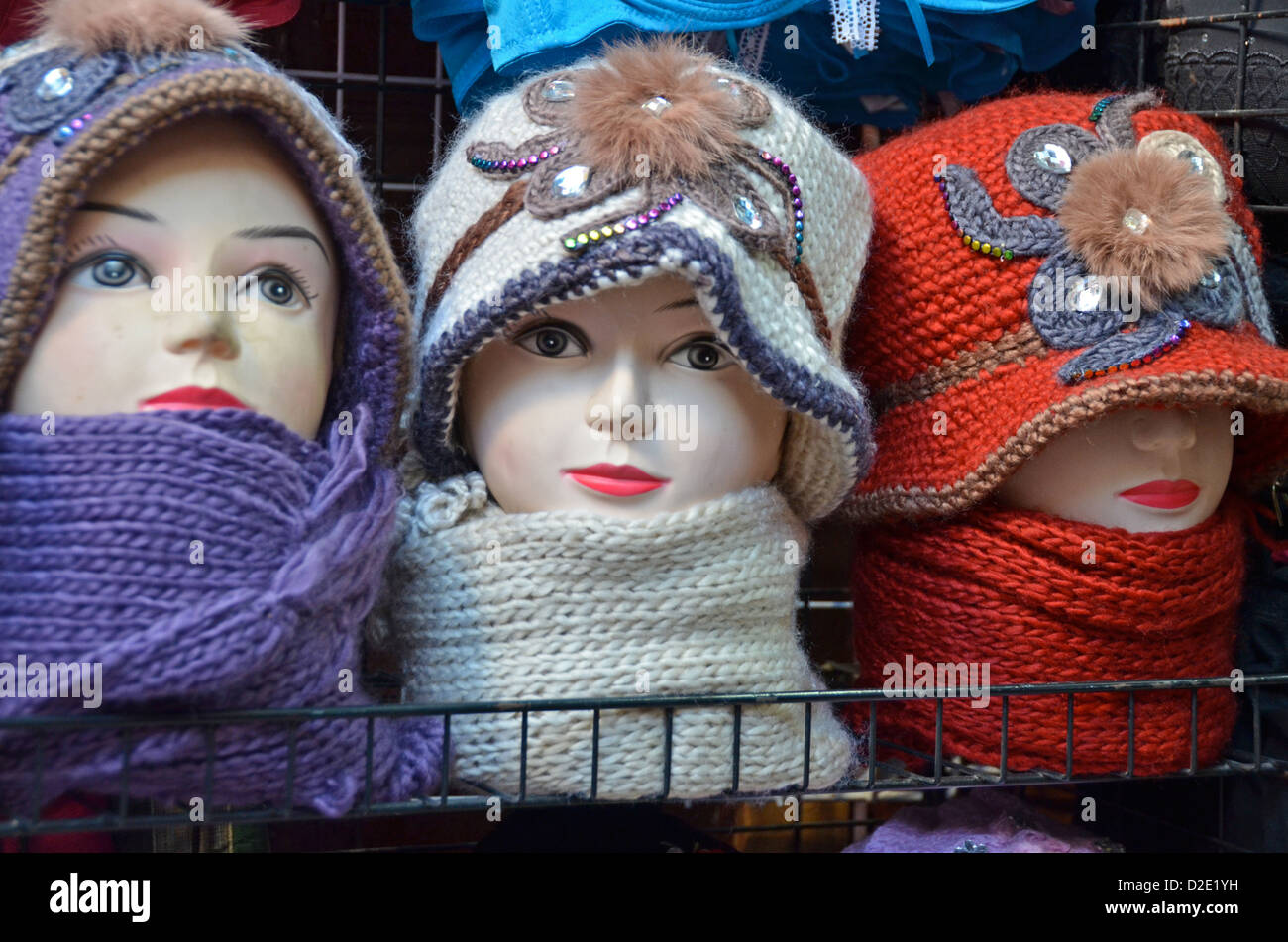 Hijabs and hats for sale in the souk, Morocco - Stock Image