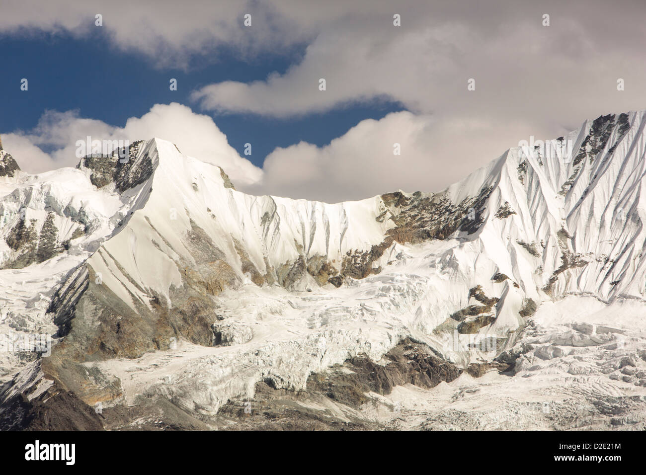 A rapidly retreating glacier on the side of the 6428 metre peak of Gandharwa Chuli in the annapurna sanctuary, Nepalese - Stock Image