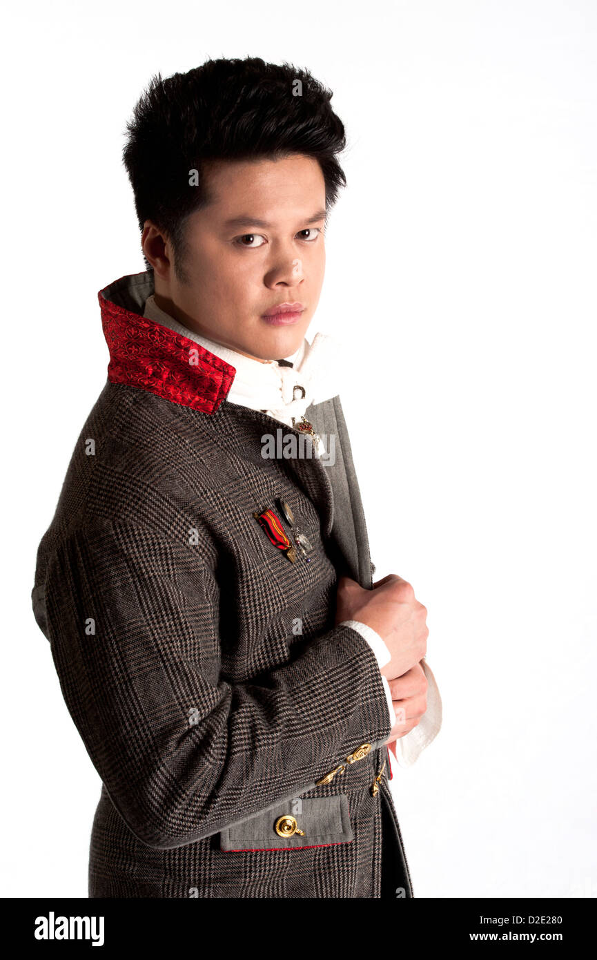 Asian man in twenties with exaggerated clothing, Sci-fi character portrait - Stock Image