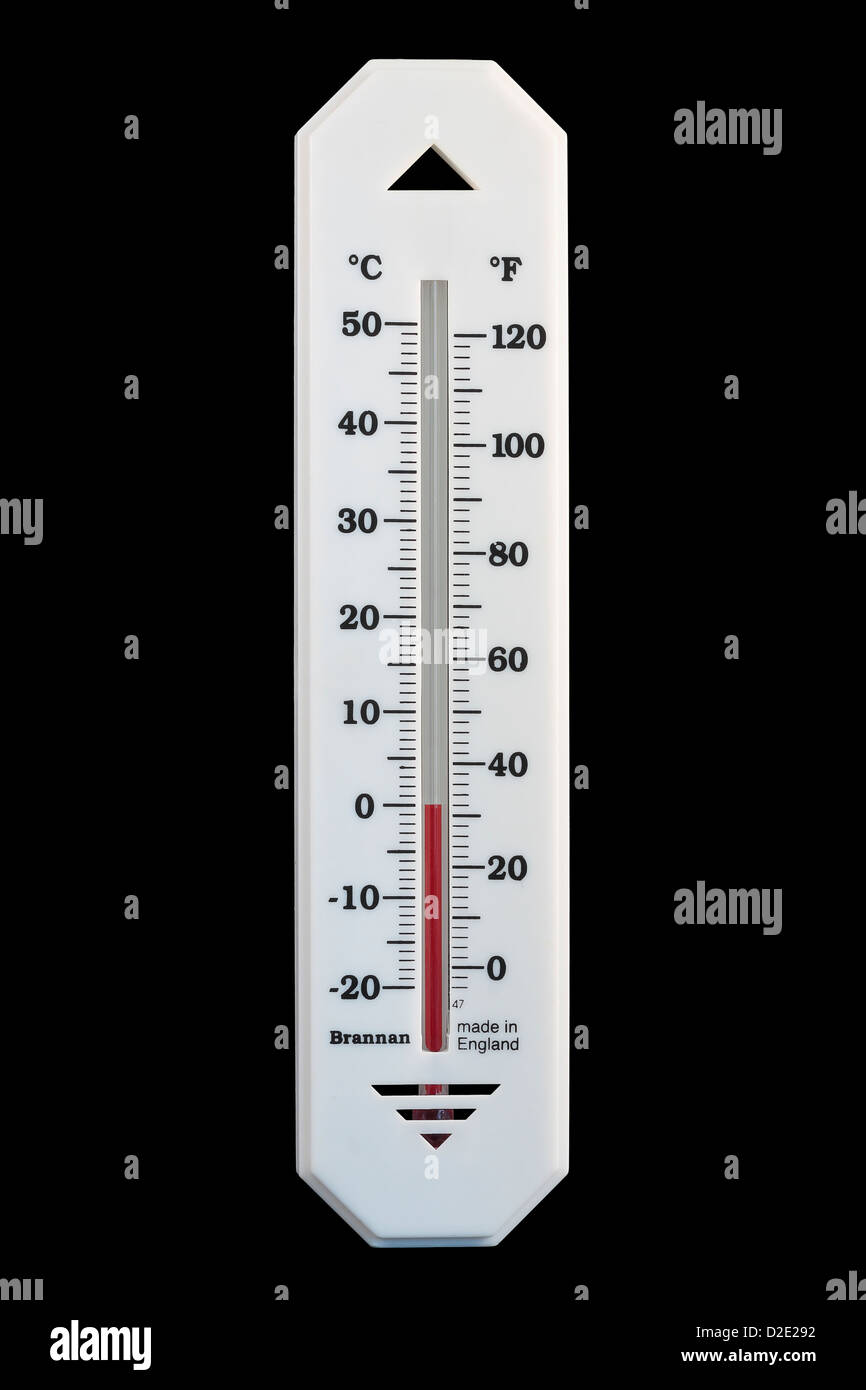 Celsius Centigrade and Fahrenheit Alcohol in Glass Thermometer reading 0ºC 32ºF isolated on black background - Stock Image