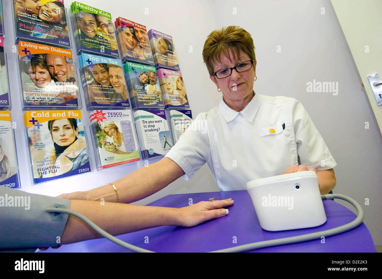 Nurse taking a patients blood pressure. - Stock Image