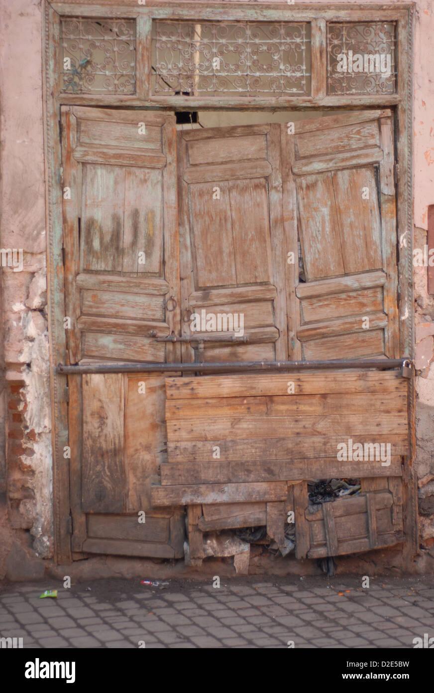 Old decrepit wooden door in marrakesh Stock Photo