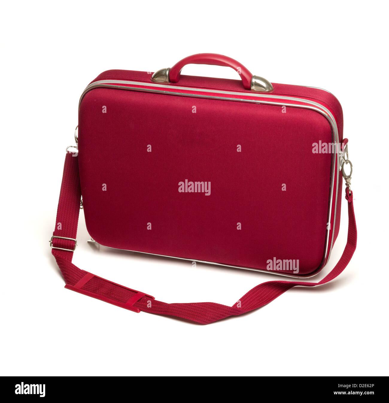 Red suitcase isolated on white background - Stock Image