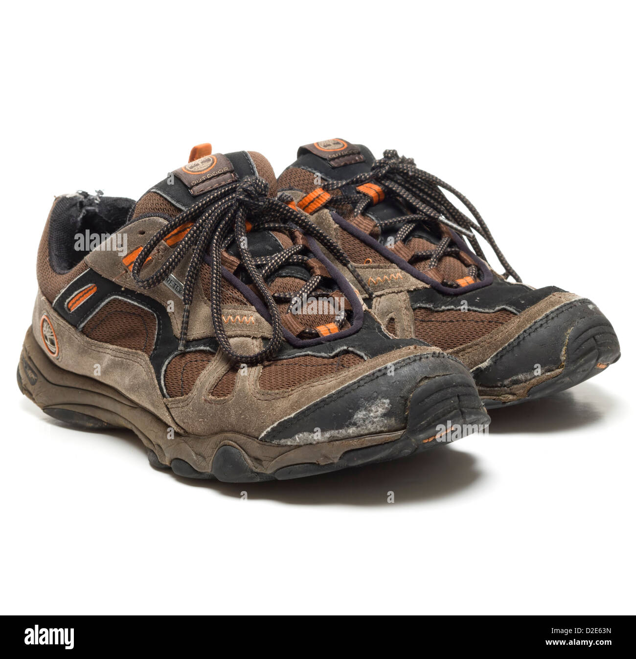 One pair of worn out brown Timberland hiking shoes - Stock Image