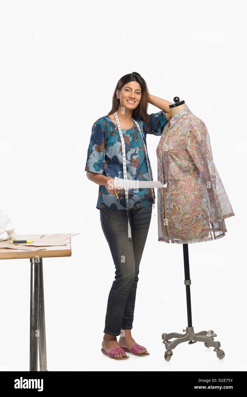 Female Fashion Designer Sketching A Dress Stock Photo Alamy
