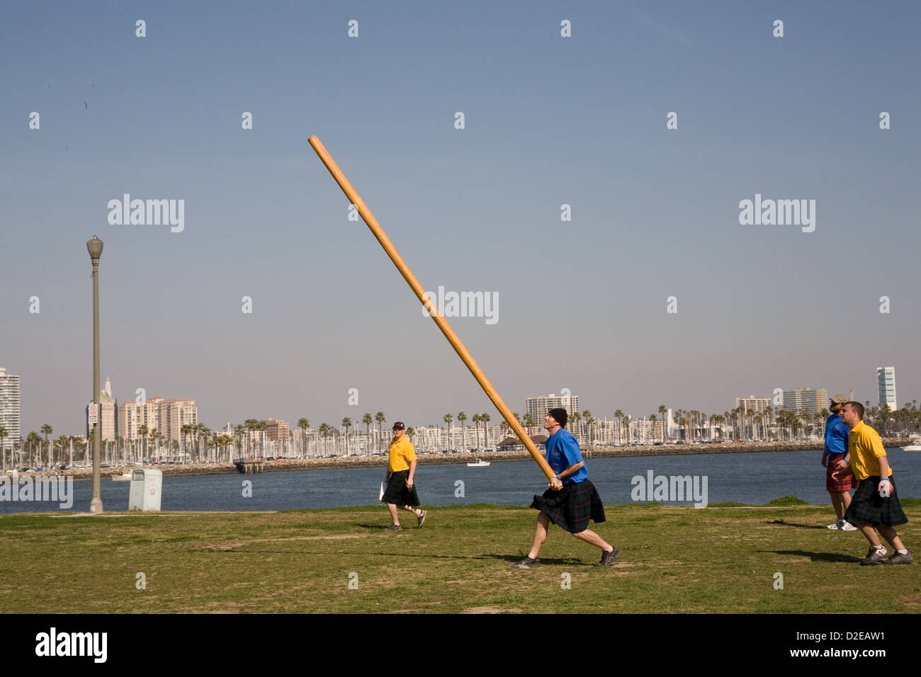 The caber toss competition at the Scotsfest Scottish Festival and clan gathering at the Queen Mary in Long Beach, - Stock Image