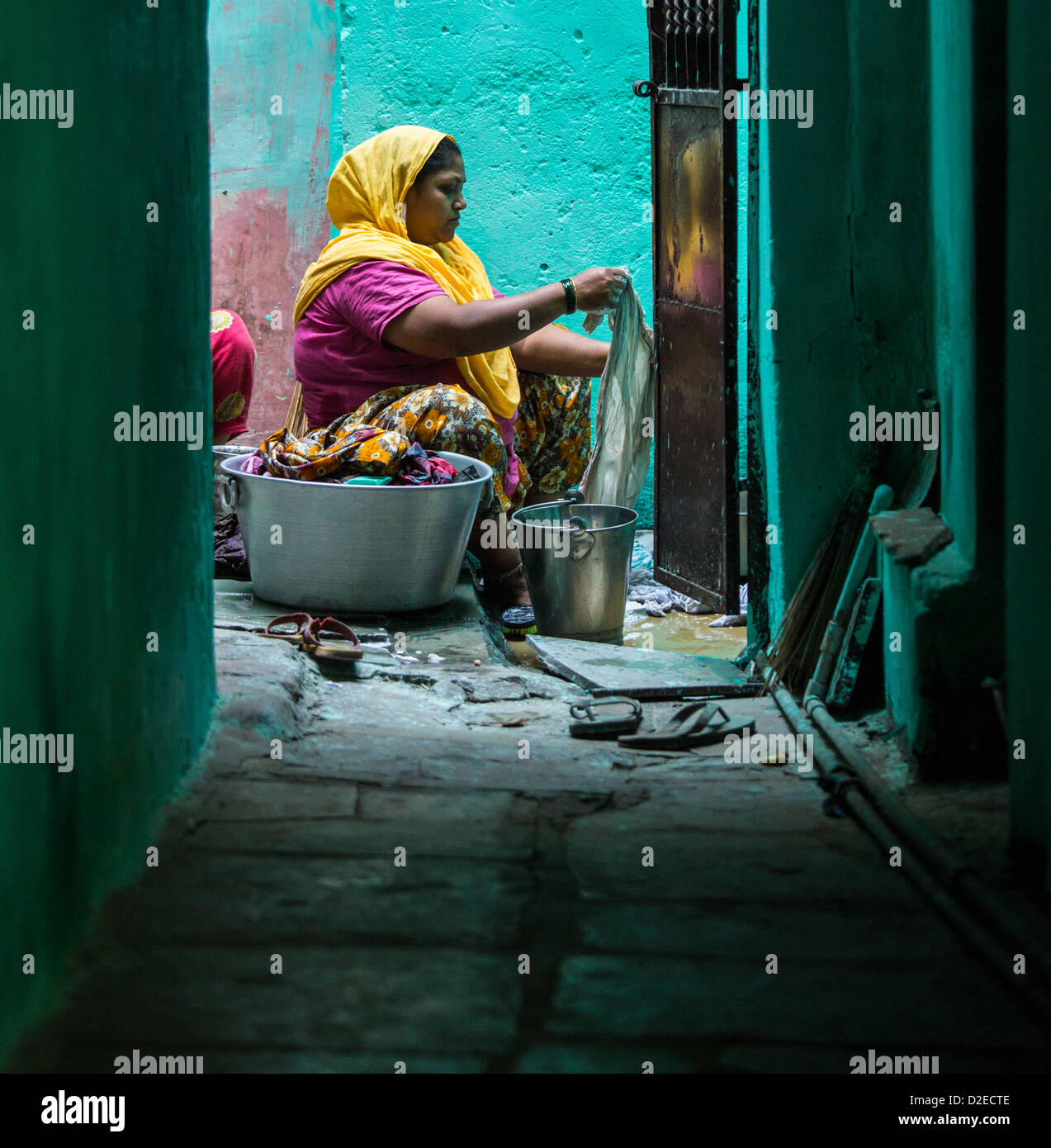 Woman washing clothes in the old town, Ahmedabad, Gujarat, India - Stock Image