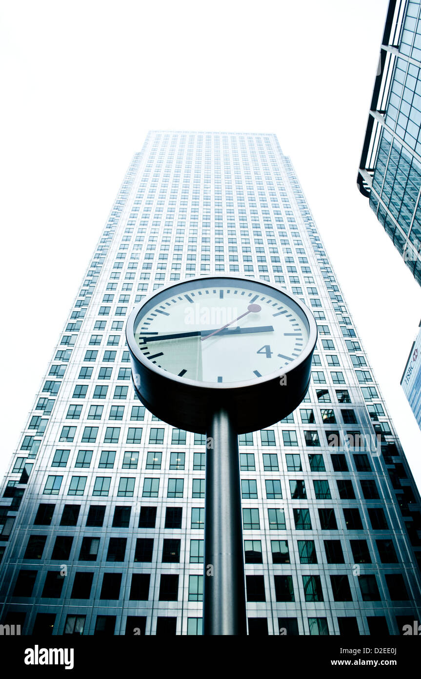 Canary Wharf Clock in front of One Canada Square Building, London, UK - Stock Image