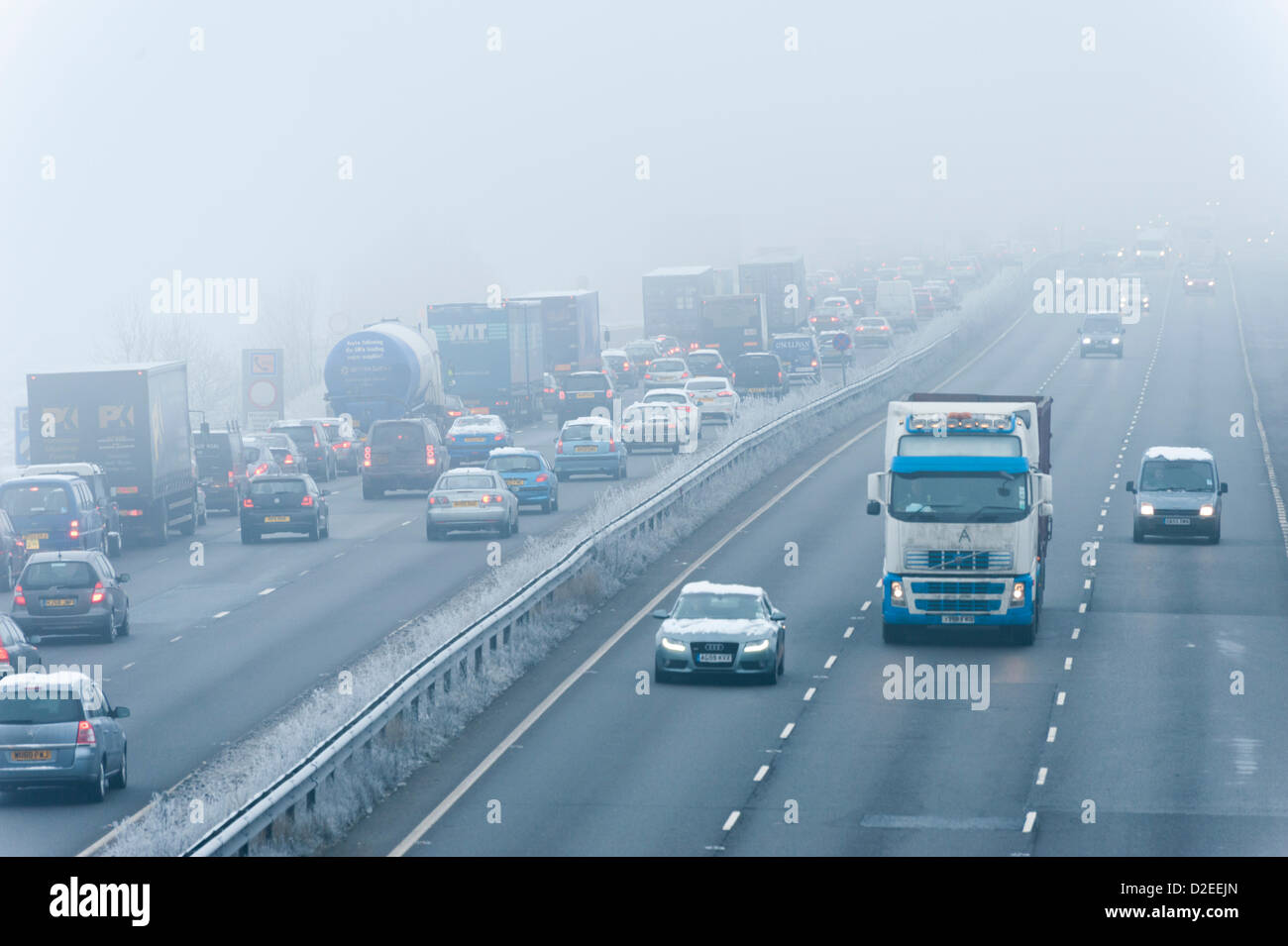Drivers face freezing fog on the A14 north of Cambridge on 22nd January 2013. The temperature plunged to minus 8 - Stock Image