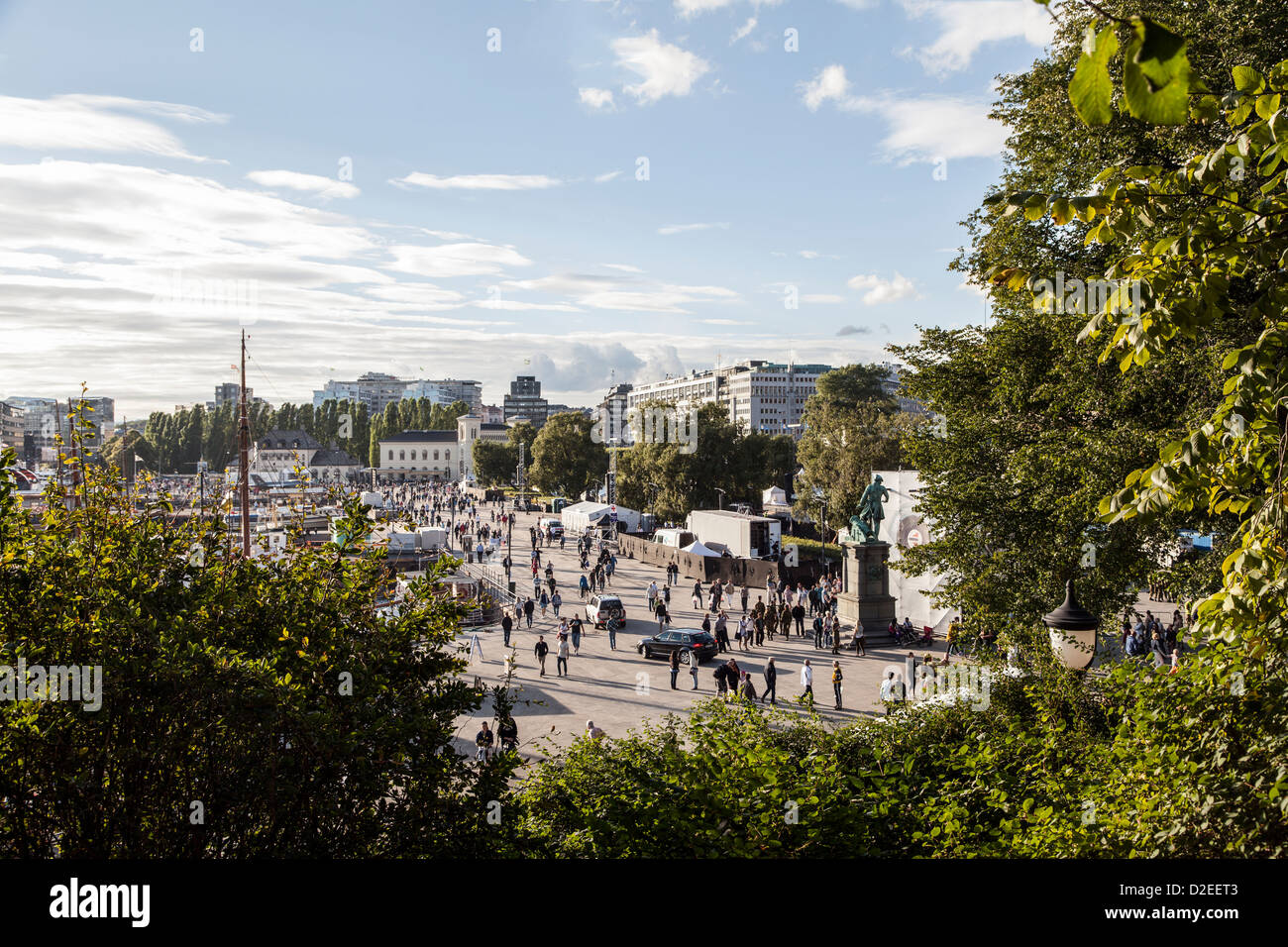Tourists enjoy the summer sun nearby the city port in Oslo, Norway. Stock Photo