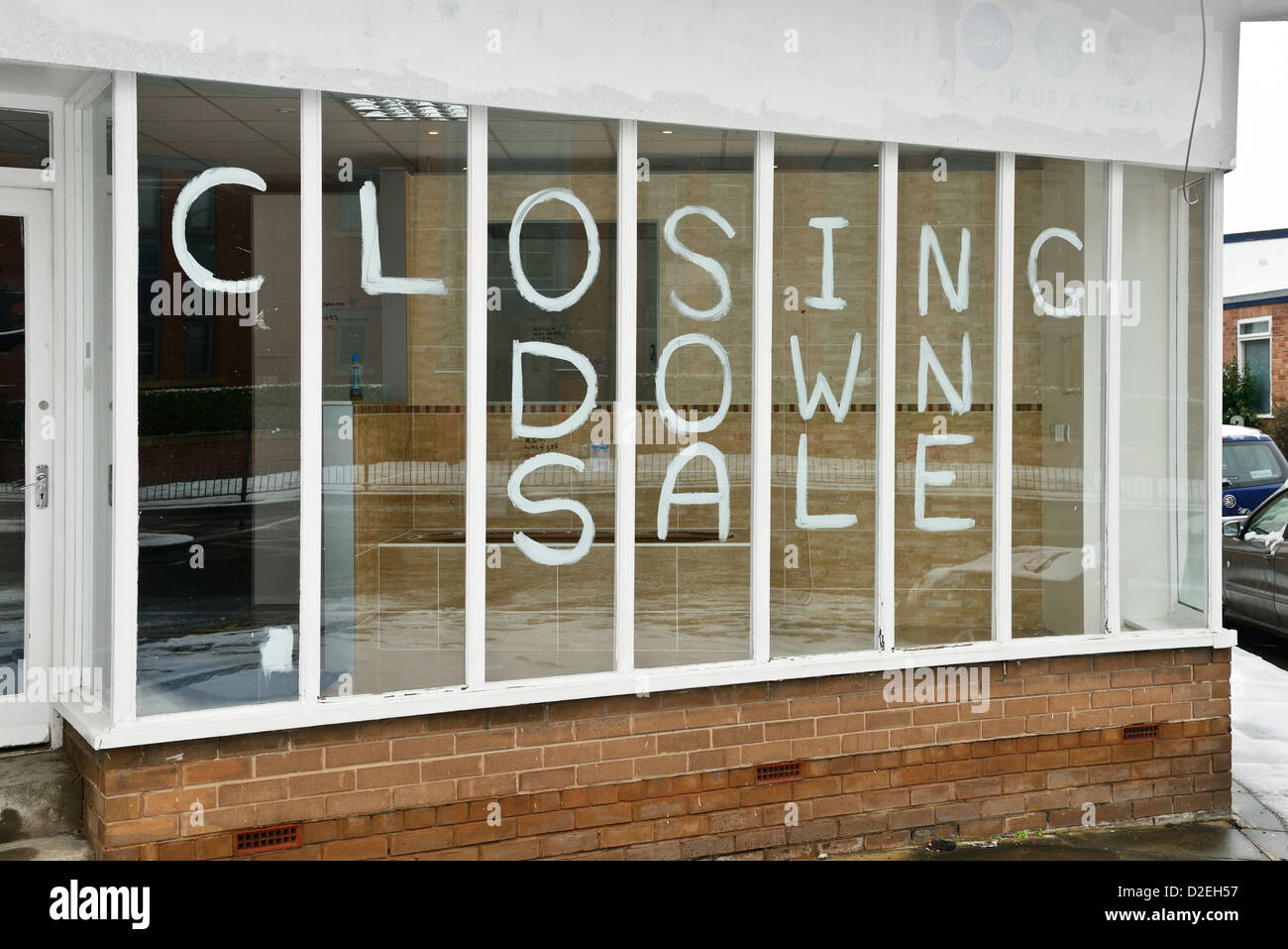 Closing down sale notice in a shop window - Stock Image