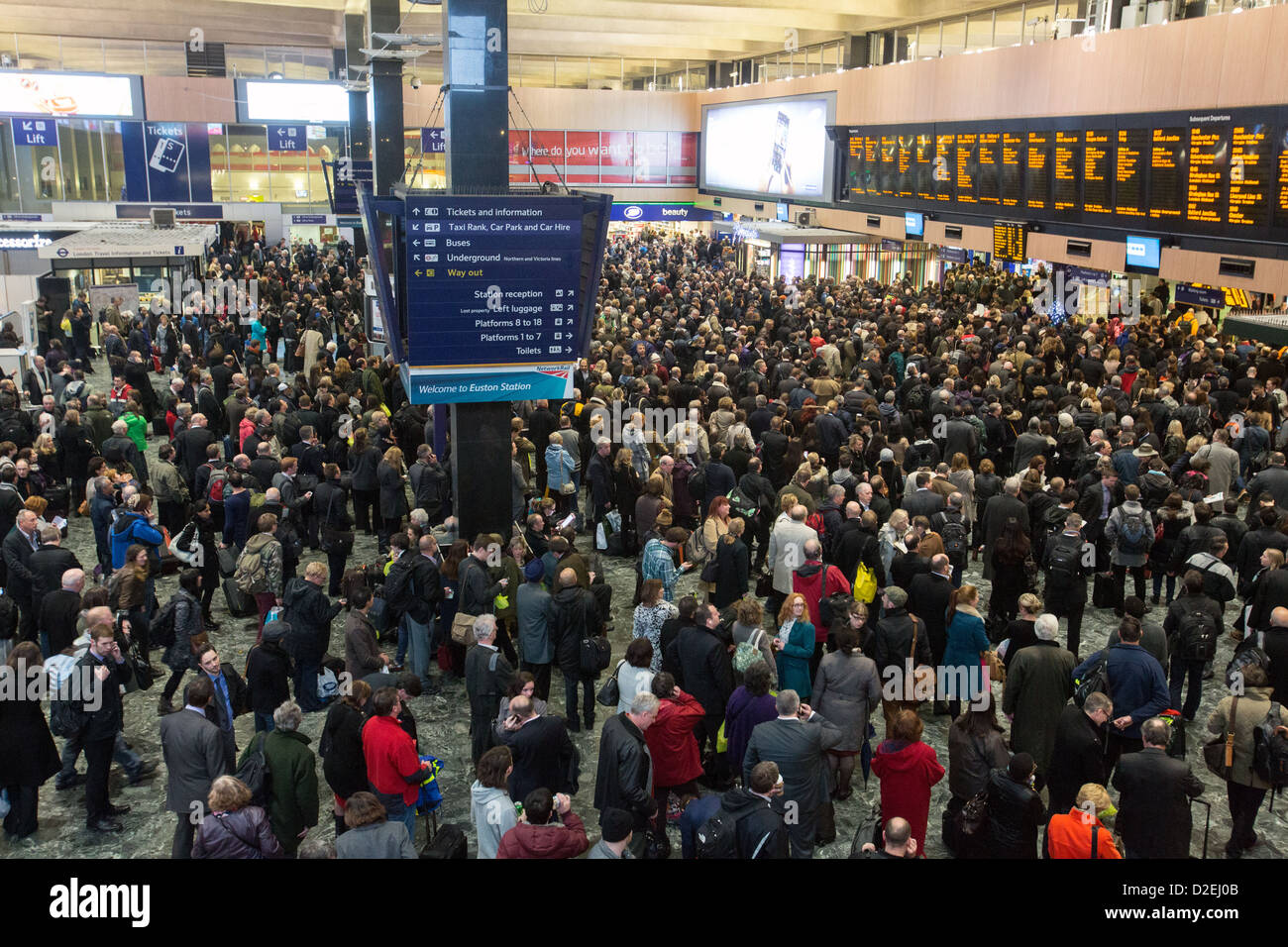 A crowded concourse at Euston Station in London - Stock Image