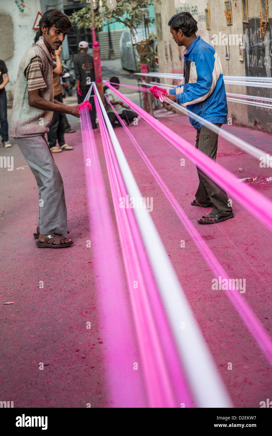 Coating kite string with ground glass for the Kite Festival or Uttarayan in Ahmedabad, Gujarat, India - Stock Image