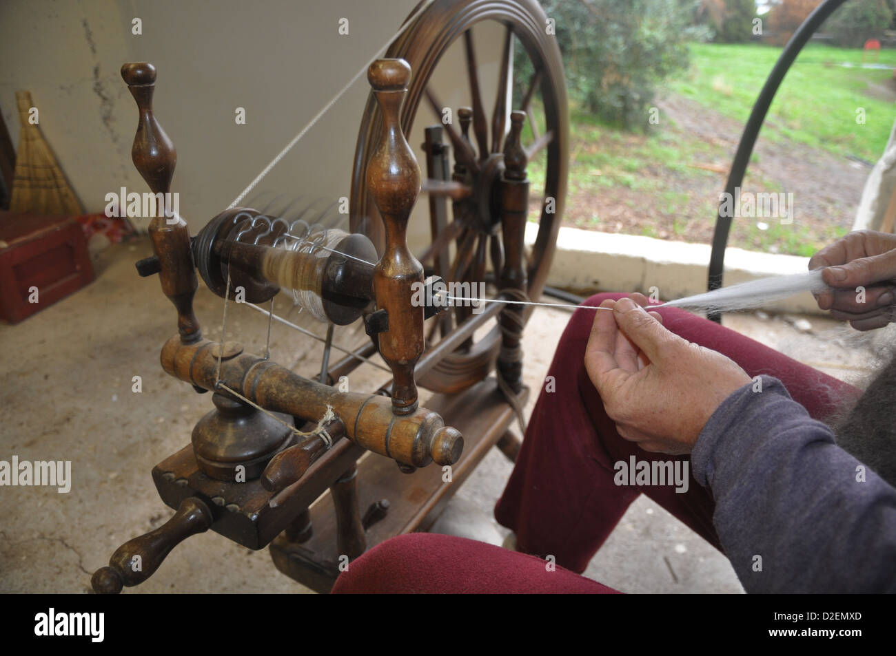 Old Fashioned manual wool spinning wheel - Stock Image